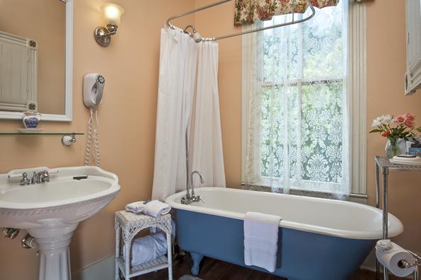 The Magnolia bathroom blue bath tub
