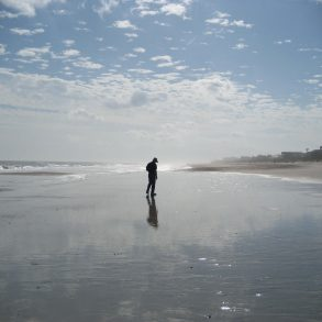 man walking on beach