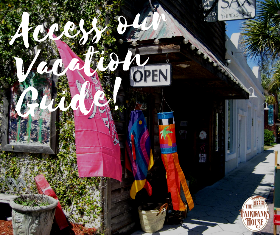 exterior view of one of the charming shops in downtown amelia island text reads access our vacation guide
