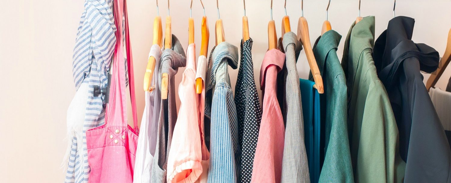 colorful blouses hanging on a shopping rack