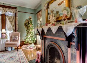 The Tapestry Room decorated at Christmas time the beautiful soapstone fireplace