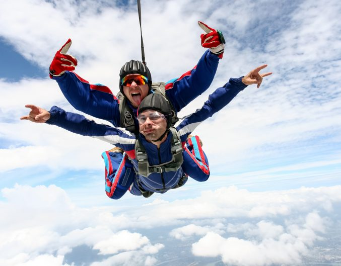 Tandem jump in the sky with clouds. skydiving florida