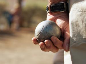 petanque ball player holding